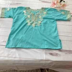 - Size MED/Large Turquoise top.